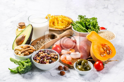 Obraz Mediterranean diet concept - meat, fish, fruits and vegetables on bright green background