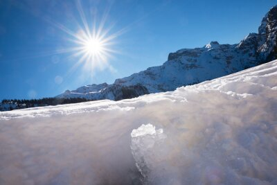 Obraz melting ice and snow, mountain landscape with blue sky and bright sun