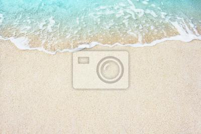 Obraz Miękkie fala błękitnego oceanu na piaszczystej plaży, tło.