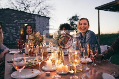Obraz Millennials enjoying dinner in outdoor restaurant