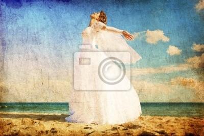 Młoda panna młoda na plaży