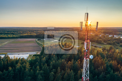 Obraz Mobile communication tower during sunset from above.