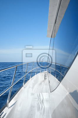 Modern boat side and railing on a sunny day, luxury travel concept.