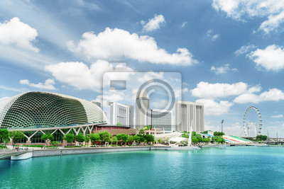 Modern buildings and Marina Bay with azure water in Singapore