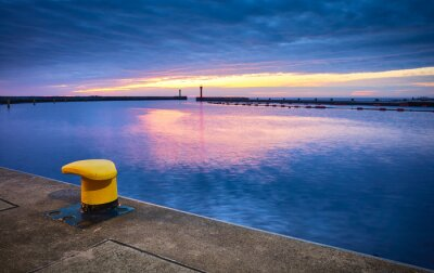 Mooring bollard in a harbor during the blue hour.