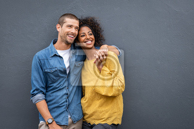 Obraz Multiethnic couple in love standing and holding hands