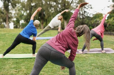 Obraz Multiracial people doing yoga at park with social distance for coronavirus outbreak