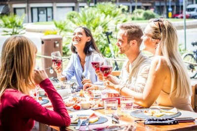 Obraz Multiracial people drinking red wine at open bar restaurant - Group of friends laughing having fun dining together outdoor -  Bright filter