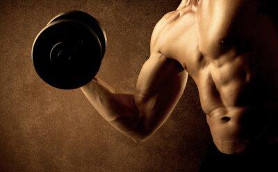 Obraz Muskularny dopasowanie sportowiec kulturysta wagi podnoszenia