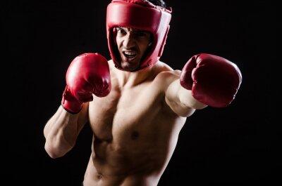 Obraz Muskularny mężczyzna w boksie koncepcji