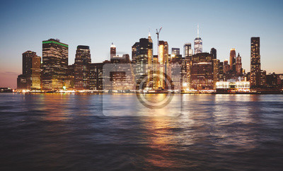 New York City at dusk, color toned picture.
