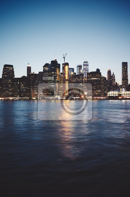 New York City at dusk, color toned picture, USA.