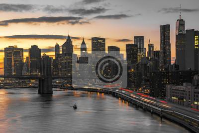 New York City night lights against black and white skyline buildings in Manhattan