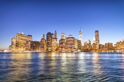 New York City night lights. Lower Manhattan skyline from Brooklyn Bridge Park promenade - USA