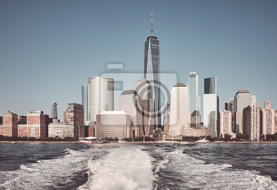 New York City seen from a ferry, color toning applied, USA.