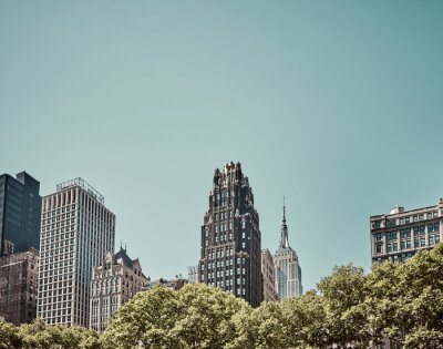 New York City skyline on a sunny cloudless day, vintage color toning applied, USA.