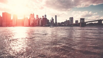 New York City skyline seen from Brooklyn at sunset, color toning applied, USA.