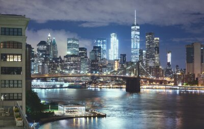 Obraz New York cityscape at night, Brooklyn Bridge and Manhattan seen from Brooklyn Dumbo, color toning applied, USA.