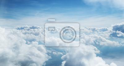 Obraz Niebieskie niebo i chmury tło z dużą ilością miejsca na kopię.