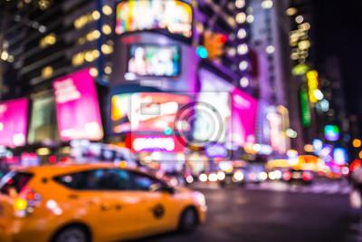 Obraz Nieostre plamy na Times Square w Nowym Jorku w nocy z światła i taksówką kabiny