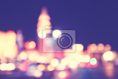 Niewyraźne światła miasta w nocy, stosowane kolory tonizujące.