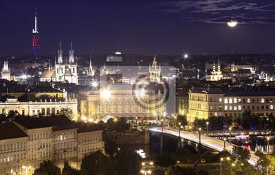 Night Prague cityscape at full moon.