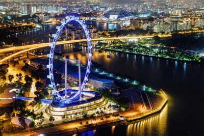 Night view of downtown with giant Ferris wheel in Singapore