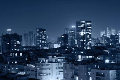 Obraz Night view of the city life. Light of the buildings shining with cool blue tones. View of night scene of Tel Aviv, Israel. Blue tone city scape.