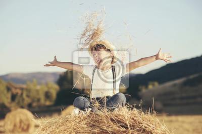 Obraz Niño Feliz en el campo