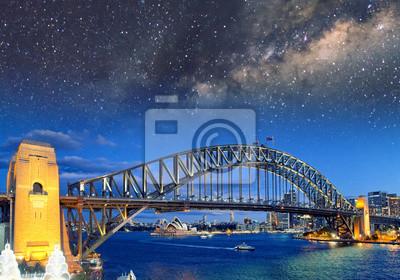 Nocny widok z gwiazdami Sydney Harbour Bridge od Luna Park Ferris Wheel, Australia