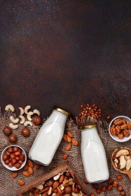 Obraz nut milk in glass bottles