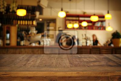 Obraz Obraz drewniany stół z przodu abstrakcyjna rozmyte światła restauracja światła