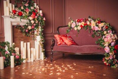 Obraz ognisko sofa w kwiaty