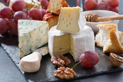 Obraz Okładzina sery i przekąski na tablicy