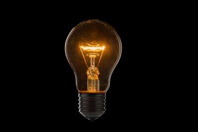 Obraz Old, dirty light bulb close up on black background
