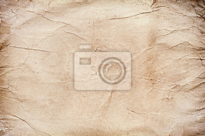 Old grungy stained paper background or texture.