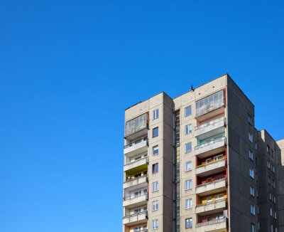 Old residential building against the blue sky