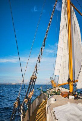 Old schooner sailing along the coast of Rugen Island, Germany.