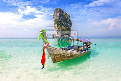 Old wooden boat on a tropical beach, holiday background.