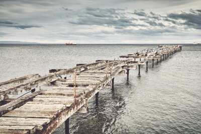 Old wooden bridge in Punta Arenas, color toning applied, Chile.