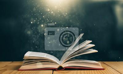 Obraz Otwórz książkę na starym drewnianym stole