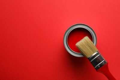 Obraz Paint can and brush on red background, top view