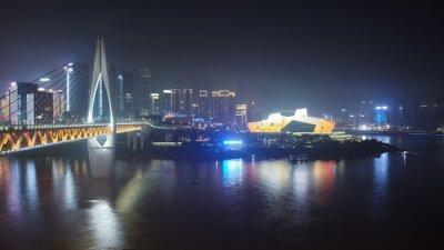 Panorama of Chongqing shrouded in smog at night, China.