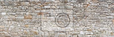 Obraz Panorama - stara szara ściana z grubych, wielu małych, prostokątnych ociosanych kamieni naturalnych
