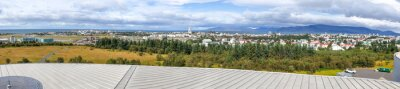 Panoramic aerial view of Reykjavik from a city rooftop in summer season