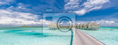 Obraz Panoramic landscape of Maldives beach. Tropical panorama, luxury water villa resort with wooden pier or jetty. Luxury travel destination background for summer holiday and vacation concept.