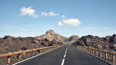 Panoramic view of a scenic road in Teide National Park, color toning applied, Tenerife, Spain.
