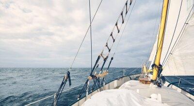 Panoramic view of an old schooner sailing the ocean.