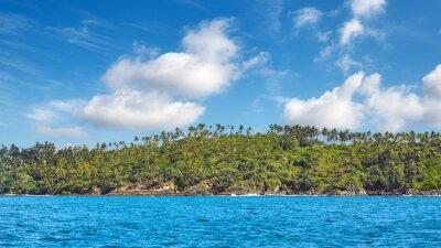 Panoramic view of tropical island coastline.