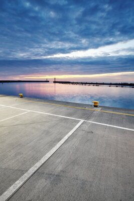Parking lot in a harbor during the blue hour.